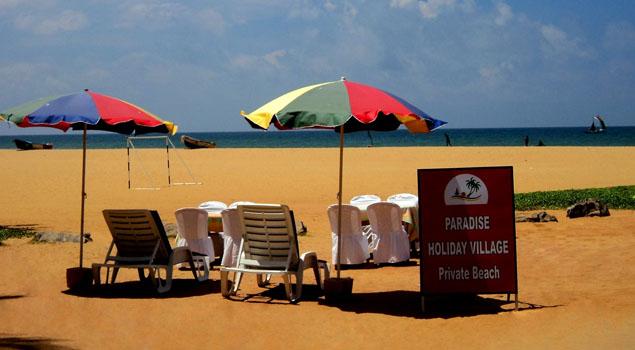 Strand van Paradise Holiday Village